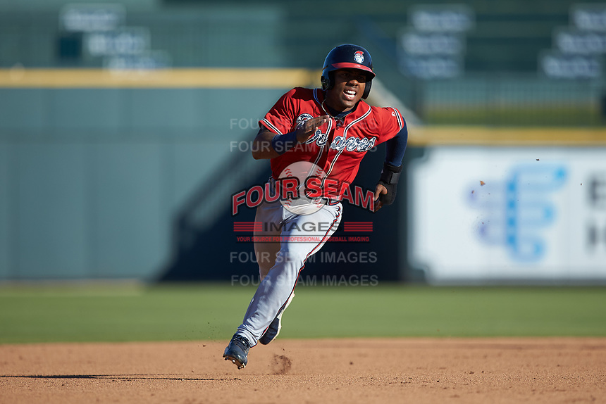Justin Dean (5) of the Rome Braves hustles towards third base against the Columbia Fireflies at Segra Park on May 13, 2019 in Columbia, South Carolina. The Fireflies walked-off the Braves 2-1 in game one of a doubleheader. (Brian Westerholt/Four Seam Images)