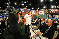 Catcher Clint Coulter (Union H.S.) the number twentyseventh overall pick to the Milwaukee Brewers takes a phone call from Brewers management while Brewers represenatives Mark Mueller and Don Money look on during the MLB Draft on Monday June 04,2012 at Studio 42 in Secaucus, NJ.   (Tomasso DeRosa/ Four Seam Images)