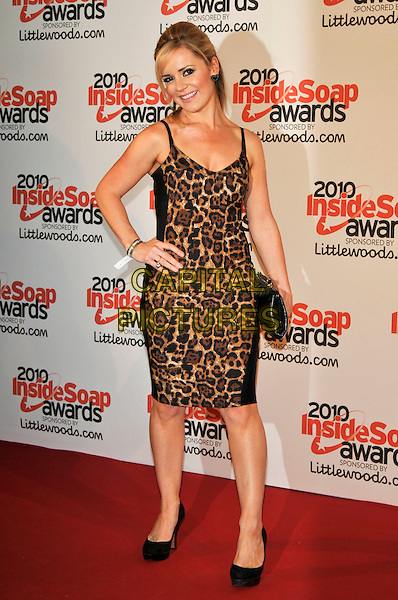 RACHEL LESKOVAC.Attending the Inside Soap Awards 2010 held at Shaka Zulu, Camden, London, England, UK..September 27th 2010 .arrivals full length black leopard print dress animal clutch bag shoes hand on hip.CAP/PL.©Phil Loftus/Capital Pictures.