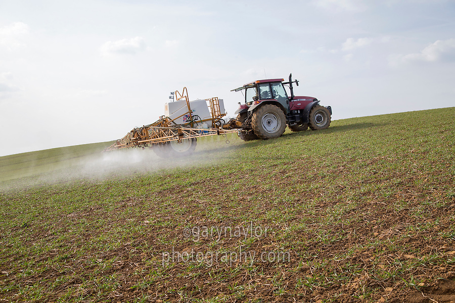 Spraying winter wehat with herbicide - Leicestershire - March