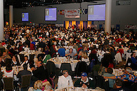 Thursday March 4, 2010      .An audience of just over 2,000 people , the largest banquet in the State of Alaska , watches the Iditarod musher's draw for position at the Dena ' ina center in Anchorage..