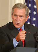 Washington, D.C. - June 24, 2005 -- United States President George W. Bush responds to a question as he holds a joint press conference with Prime Minister Ibrahim al-Jaafari of Iraq in the East Room at the White House in Washington, D.C. on June 24, 2005.  They discussed the re-building of Iraq and refused to give a time-table for the withdrawal of United States forces.<br /> Credit: Ron Sachs / CNP