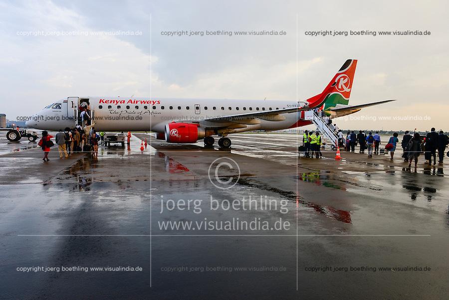 KENYA, Nairobi, JKIA Jomo Kenyatta International airport, passenger board a Kenya Airways aircraft Embraer 190 after a rain shower