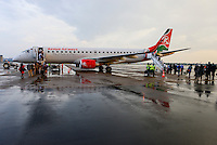 KENYA, Nairobi, JKIA Jomo Kenyatta International airport, passenger board a Kenya Airways aircraft Embraer 190 after a rain shower