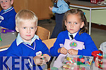 Taironas Svirskis and Austeda Bataitiene check out some toys on their first day at School in Killorglin on Monday.