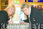 In to win: Ballybunion locals Margaret Hayes and Annemarie Tydings filling out their lottery tickets this week at Dana Mulvihill's newsagents in the town where Kerry's largest jackpot lottery ticket of EUR7.7M was sold last week.