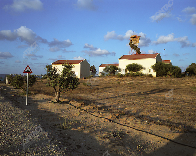An Israeli watchtower stands over the house of Ruth and Yacov Etsion in Morag settlement within the Gush Katif block of settlements, July 2005.