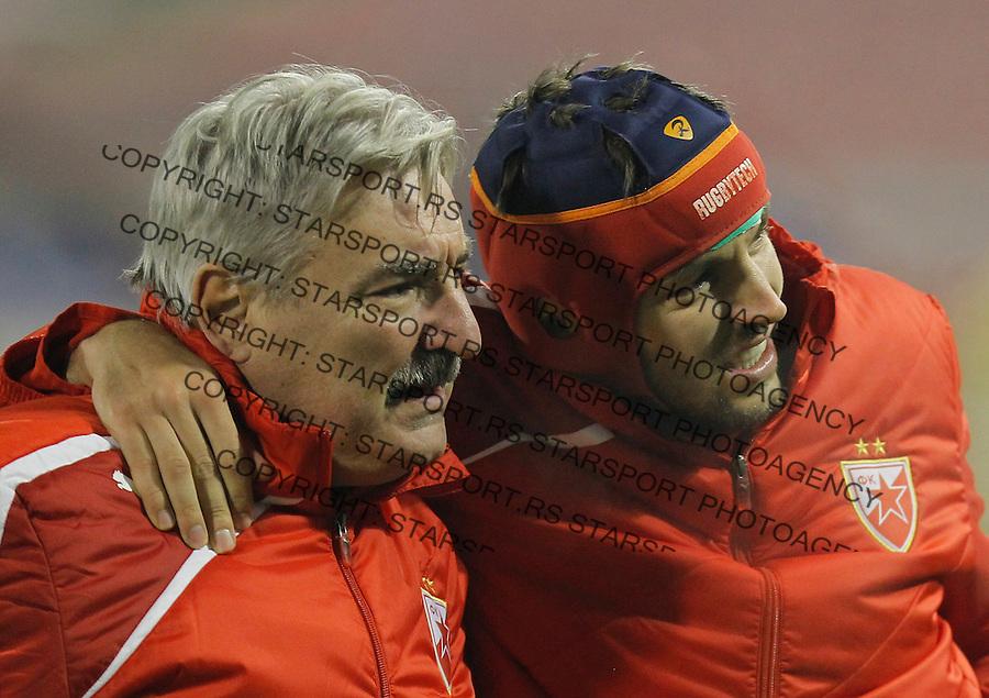 Fudbal Kup Srbije season 2013-2014<br /> Crvena Zvezda v Vojvodina<br /> Milos Ninkovic (R) injured povreda<br /> Beograd, 04.12.2013.<br /> foto: Srdjan Stevanovic/Starsportphoto &copy;