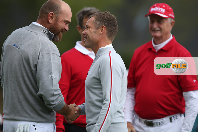 Thomas Bjorn (DEN) shakes hands with Le Mans legend Tom Kristensen during the Made in Denmark 2014 Pro-Am from the Himmerland Golf & Spa Resort, Aalborg, Denmark. Picture:  David Lloyd / www.golffile.ie