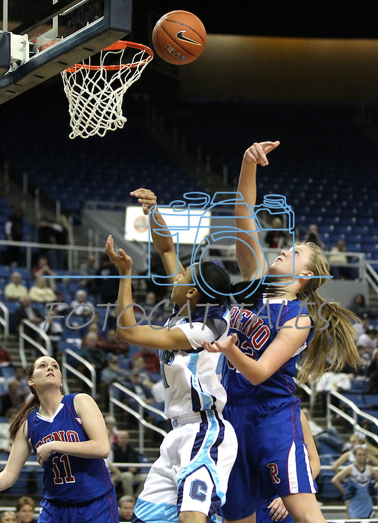 Reno's Morgan McGwire swats the shot of Tramina Jordan of Centennial during the semi-final game at the NIAA 4A State Basketball Championships between Centennial and Reno high schools at Lawlor Events Center in Reno, Nev, on Thursday, Feb. 23, 2012. Reno won 60-41. .Photo by Cathleen Allison