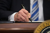 US President Donald J. Trump signs a presidential proclamation on steel tariffs in the Roosevelt Room of the White House in Washington, DC, USA, 08 March 2018. President Trump is imposing tariffs on steel and aluminum imports. A decision to impose the tariffs on Canada or Mexico will not be decided until negotiations on the North American Free Trade Agreement (NAFTA).<br /> Credit: Michael Reynolds / Pool via CNP