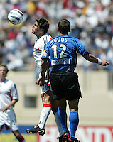 DC United forward Jamie Moreno and San Jose Earthquakes defender Jeff Agoos jump for a header during their MLS match on May 1, 2004 at Spartan Stadium in San Jose, California.