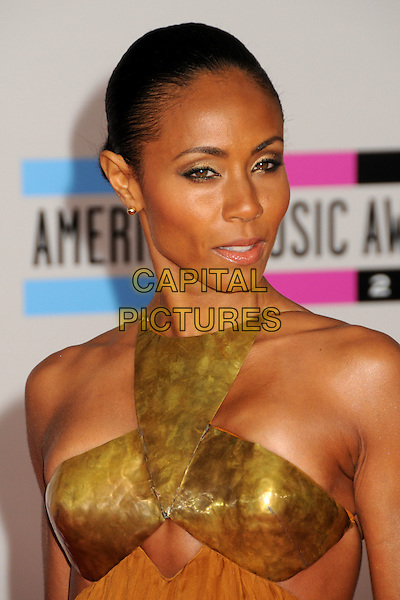 JADA PINKETT SMITH.2010 American Music Awards - Arrivals held at Nokia Theatre L.A. Live, Los Angeles, California, USA..November 21st, 2010.headshot portrait gold metallic hair up metal armour .CAP/ADM/BP.©Byron Purvis/AdMedia/Capital Pictures.