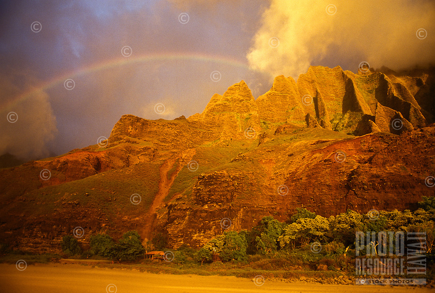 Rainbow over Kalalau valley at sunset, Na Pali coastline of Kauai
