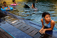 Wai Hnin (right) one of the 'Me N Ma Girls', Myanmar's first girl band, swims with her band mates during a break in the filming of a video to go with their next release. The band's members were recruited by Australian dancer Nicole May. They sing and dance in the manner of many Western pop acts but in socially conservative Myanmar, they represent a radical break from the norm.