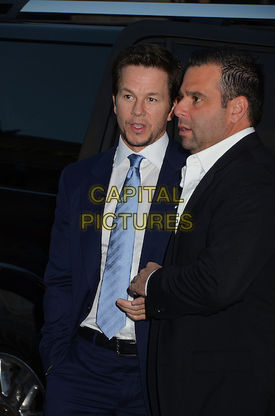 "Mark Wahlberg & guest.The L.A. Premiere of ""Pain & Gain"" held at The TCL Chinese Theatre in Hollywood, California, USA..April 22nd, 2013.half length blue stubble facial hair profile side tie shirt suit black .CAP/ADM/BT.©Birdie Thompson/AdMedia/Capital Pictures"