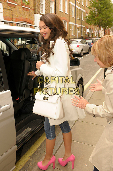 Zendaya Cole from the Disney show 'Frenemies' in central London, England..17th May 2012.full length denim beige shoes pink shorts jean mac white side car profile .CAP/IA.©Ian Allis/Capital Pictures.
