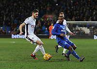Cardiff City's Junior Hoilett under pressure from Bolton Wanderers' Dorian Dervite<br /> <br /> Photographer Kevin Barnes/CameraSport<br /> <br /> The EFL Sky Bet Championship - Cardiff City v Bolton Wanderers - Tuesday 13th February 2018 - Cardiff City Stadium - Cardiff<br /> <br /> World Copyright &copy; 2018 CameraSport. All rights reserved. 43 Linden Ave. Countesthorpe. Leicester. England. LE8 5PG - Tel: +44 (0) 116 277 4147 - admin@camerasport.com - www.camerasport.com