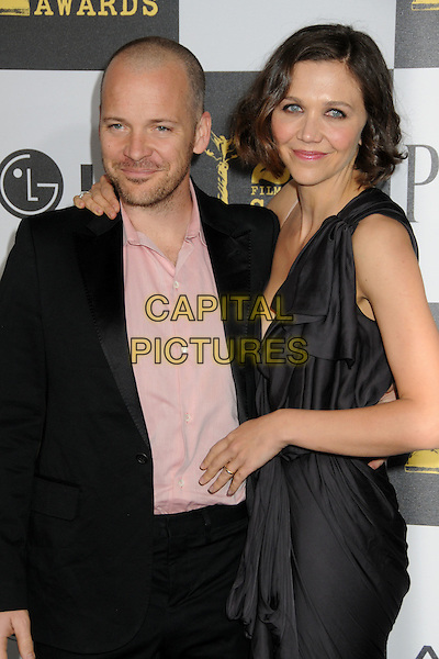 PETER SARSGAARD & MAGGIE GYLLENHAAL.25th Annual Film Independent Spirit Awards - Arrivals held at the Nokia Event Deck at L.A. Live, Los Angeles, California, USA..March 5th, 2010.half length black grey gray one shoulder dress  stubble facial hair suit pink shirt married husband wife .CAP/ADM/BP.©Byron Purvis/AdMedia/Capital Pictures.