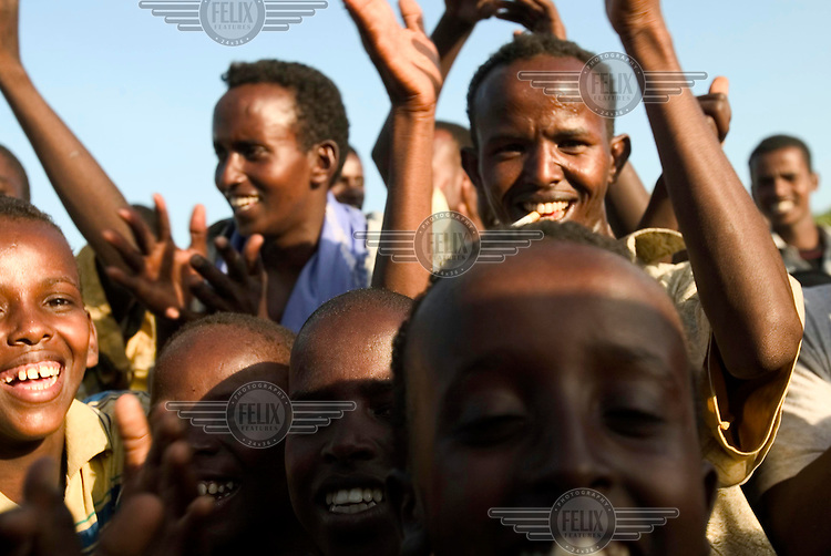 Enthusiastic crowds welcome Prime Minister Ali Mohammed Gedi and vice PM Hussein Aideed as troops of their transitional government (TFG) advance towards Mogadishu. Backed by the Ethiopian military, TFG troops quickly captured territory previously held by the Union of Islamic Courts (UIC).