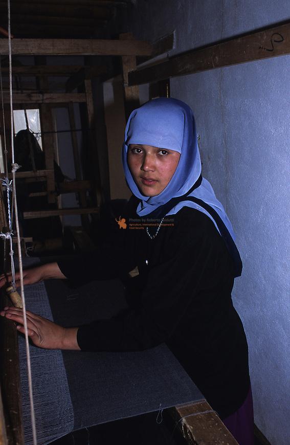 Women weaving a cover fabric