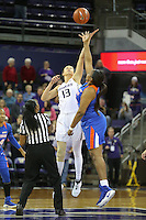 SEATTLE, WA - DECEMBER 18: Washington's #13 Katie Collier won the opening tipoff against  Savannah State's #44 Tiyonda Davis.  Washington won 87-36 over Savannah State at Alaska Airlines Arena in Seattle, WA.