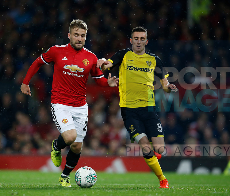 Luke Shaw of Manchester United and Matthew Lund of Burton Albion during the Carabao Cup Third Round match at the Old Trafford Stadium, Manchester. Picture date 20th September 2017. Picture credit should read: Simon Bellis/Sportimage