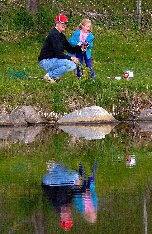 TORRINGTON, CT- 06 MAY 2006- 050606JW01.jpg  -- Rusty Nicholas of Torrington lends a hand to his daughter Brooke Nicholas age 6 while fishing at Besse Pond Saturday morning during the Torrington Parks and Recreation deparments Kids All American Fishing Derby. Jonathan Wilcox Republican-American