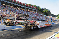 Jun. 15, 2012; Bristol, TN, USA: NHRA top fuel dragster driver Clay Millican (near lane) races alongside Terry McMillen during qualifying for the Thunder Valley Nationals at Bristol Dragway. Mandatory Credit: Mark J. Rebilas-