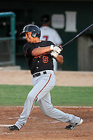 Bakersfield Blaze Designated Hitter Carlos Mendez #5 bats against the Lancaster JetHawks at Clear Channel Stadium on July 4, 2011 in Lancaster,California. (Larry Goren/Four Seam Images)