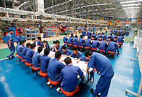 Workers of the Geely Automobiles Factory take a training session test at the factory in Taizhou, Zhejiang Province, China. Along with other auto makers in China, Geely is now looking overseas to sell its vehicles as stock increases and domestic margine declines. China is currently the world's 4th largest auto maker, plans to boost vehicle and automobile components exports by 15 folds to more than 120 billion yuan (15 billion US) in the next 10 years..