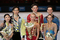 Winners in pairs figure skating are (L-R) Qing Pang and Jian Tong of China (silver), Tatiana Totmianina and Maxim Marinin of Russia (gold), Valerie Marcoux and Craig Buntin of Canada (bronze) at the Trophee Eric Bompard competition in Paris, France, November 19, 2005.  ( Photo/Tom Theobald)
