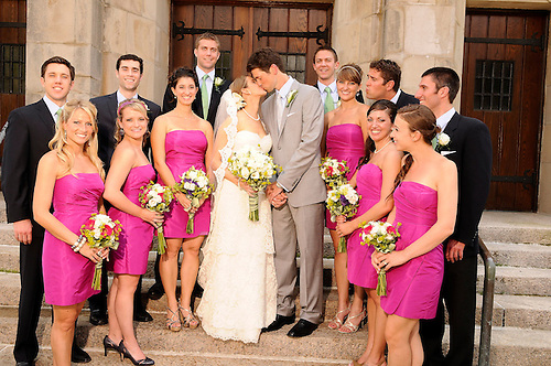 The bridal party embraces with the wedding couple outside the church in Hudson, New York.