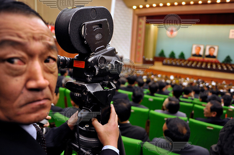 An official cameraman films with an old 16mm film camera at the People's Palace of Culture during the World Congress of the Juche Idea (Kim Il-sung's political thesis).....