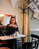 AUSTRIA, Vienna, young woman having coffee at Kleines Cafe