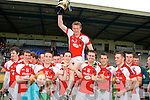 Kilcummin/Rathmore captain Chris O'Leary is held aloft by his team mates after winning the U21 County Championship against Legion in Fitzgearald Stadium on Thursday evening