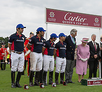 Her Majesty the Queen smiles as she talks with the Cartier Trophy Winning team (King Power) during the Cartier Queens Cup Final match between King Power Foxes and Dubai Polo Team at the Guards Polo Club, Smith's Lawn, Windsor, England on 14 June 2015. Photo by Andy Rowland.