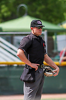 Home plate umpire Bobby Tassone looks on between innings during a Midwest League game between the Cedar Rapids Kernels and the Beloit Snappers on June 2, 2019 at Pohlman Field in Beloit, Wisconsin. Beloit defeated Cedar Rapids 6-1. (Brad Krause/Four Seam Images)