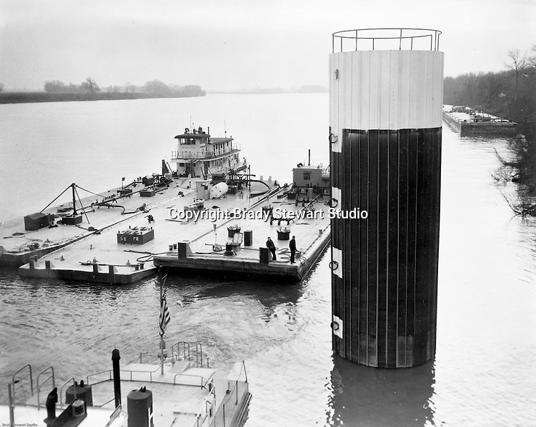 Monaca PA: View of barges being docked at a tower coated with Pittsburgh Coke and Chemical marine products.<br />