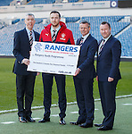 Danny Wilson presents a cheque for £175k  to the Rangers Youth Programme from the RYDC. Danny is with Colin Stewart, Stewart Robertson and academy director Craig Mulholland