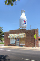 "The Milk Bottle Building on Route 66 in Oklahoma City, Oklahoma.  The 350 square foot Building was built in 1930, with the ""Milk Bottle"" beaing added in 1948 as an advertizing for the dairy industry.  The Milk Bottle Grocery was listed in the National Register of Historic Places in 1998."