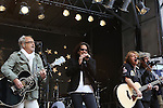 "NEW YORK, NY - JUNE 14:  Mick Jones, Kelly Hansen, Jeff Pilson and Thom Gimbel of Foreigner performs at ""FOX & Friends"" All American Concert Series outside of FOX Studios on June 14, 2013 in New York City.  (Photo by Walter McBride/FilmMagic)"