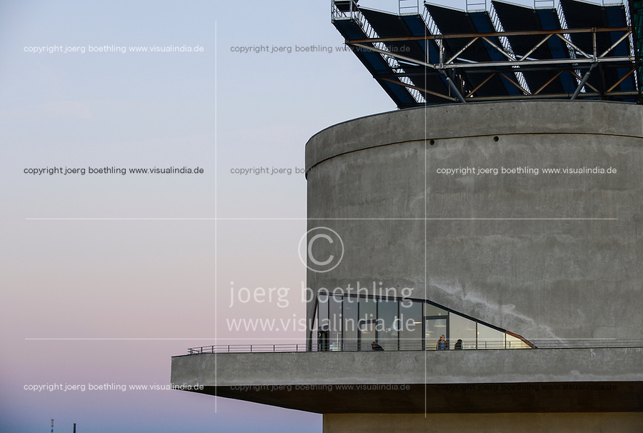 GERMANY Hamburg, Wilhelmsburg, IBA international architecture exhibition, an old anti-aircraft war bunker is changed into an 25.000 MW renewable energy project, with biogas, biomass, solar panels and solar thermal vacuum pipes, public viewing platform and coffee shop