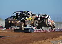 Apr 16, 2011; Surprise, AZ USA; LOORRS driver Rob MacCachren (1) leads Carl Renezeder (17) during round 3 at Speedworld Off Road Park. Mandatory Credit: Mark J. Rebilas-