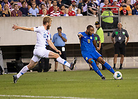 PHILADELPHIA, PA - JUNE 30: Gevaro Nepomuceno #11 shoots the ball as Tim Ream #13 defends during a game between Curaçao and USMNT at Lincoln Financial Field on June 30, 2019 in Philadelphia, Pennsylvania.