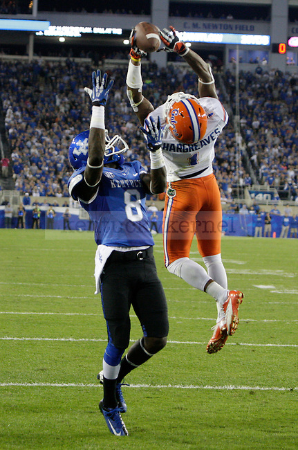 Florida Gators  Vernon Hargreaves III (1) intercepts the ball overtop of Kentucky Wildcats wide receiver Javess Blue (8) during the second half of the UK Football game against Florida at Commonwealth Stadium in Lexington, Ky., on Saturday, September, 28, 2013. Photo by Jonathan Krueger | Staff