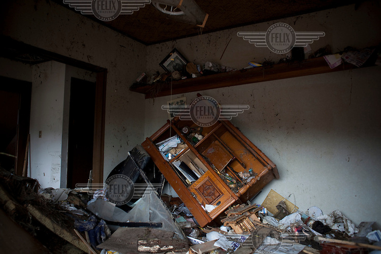 The interior of a destroyed home where two family members died. Thousands of people died in this small town which ran out of body bags. On 11 March 2011 a magnitude 9 earthquake struck 130 km off the coast of Northern Japan causing a massive Tsunami that swept across the coast of Northern Honshu. The earthquake and tsunami caused extensive damage and loss of life.