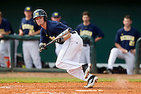 Michigan Wolverines outfielder Will Drake #4 attempts a bunt during a game against the Seton Hall Pirates at the Big Ten/Big East Challenge at Al Lang Stadium on February 18, 2012 in St. Petersburg, Florida.  (Mike Janes/Four Seam Images)