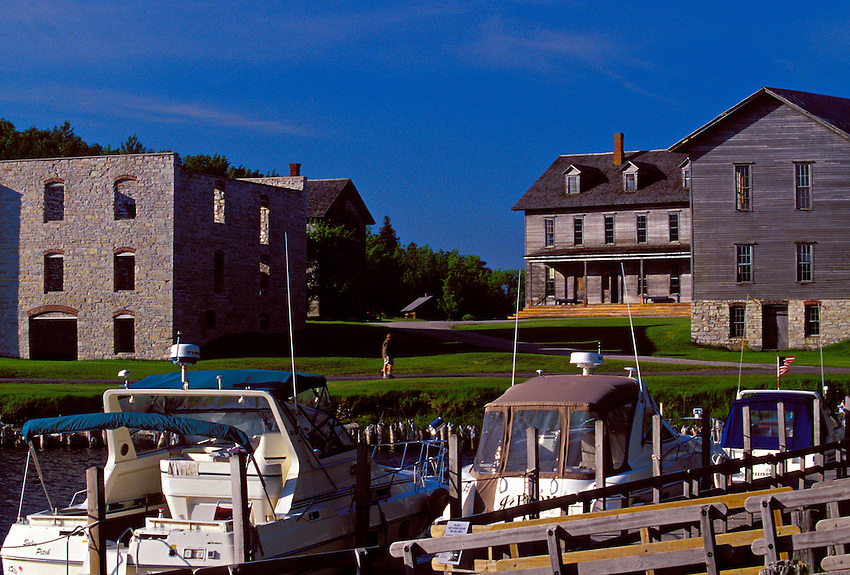 BOATS DOCK IN SNAIL SHELL HARBOR NEAR NINETEENTH CENTURY BUILDINGS AT FAYETTE STATE HISTORIC PARK ON THE GARDEN PENINSULA.