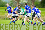 Michael Brennan St Brendan's tries to escape from Laune Rangers defenders John Sheahan, John Tyther and Geoffrey O'Mahony during their County Championship game in Killorglin Saturday evening